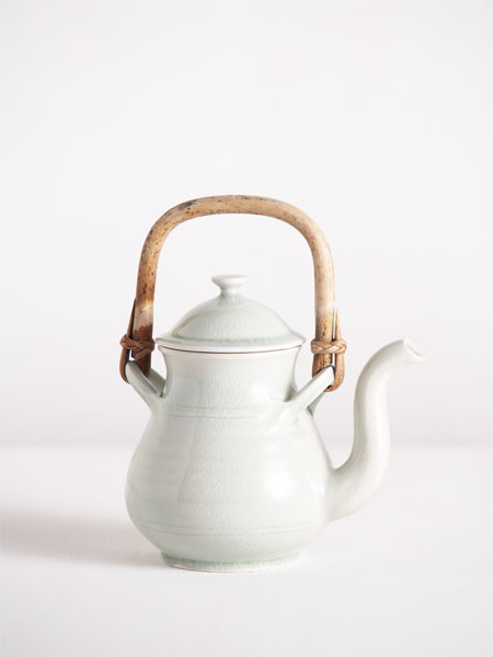teapot with celadon glaze and cane handle